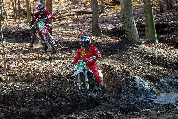 racing motorcycles in muddy woods