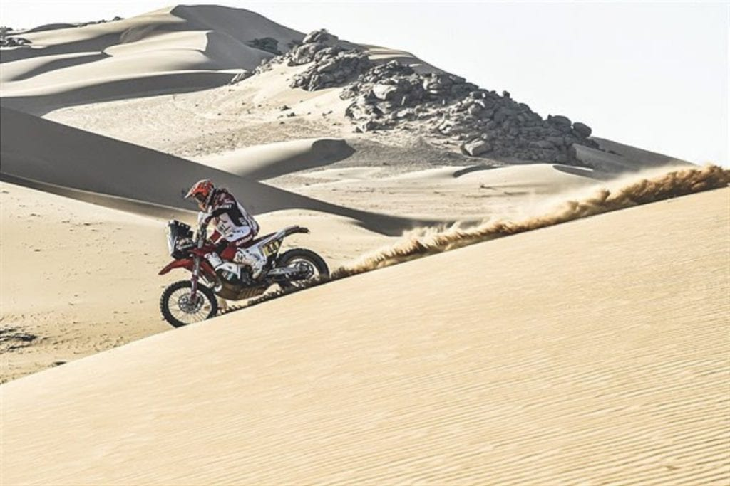 motorcycle racing in sand dunes