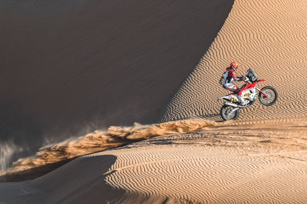 Laia Sanz riding motorcycle in sand