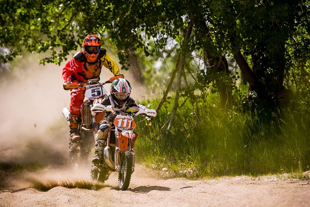 Dad and Kid Dirtbiking