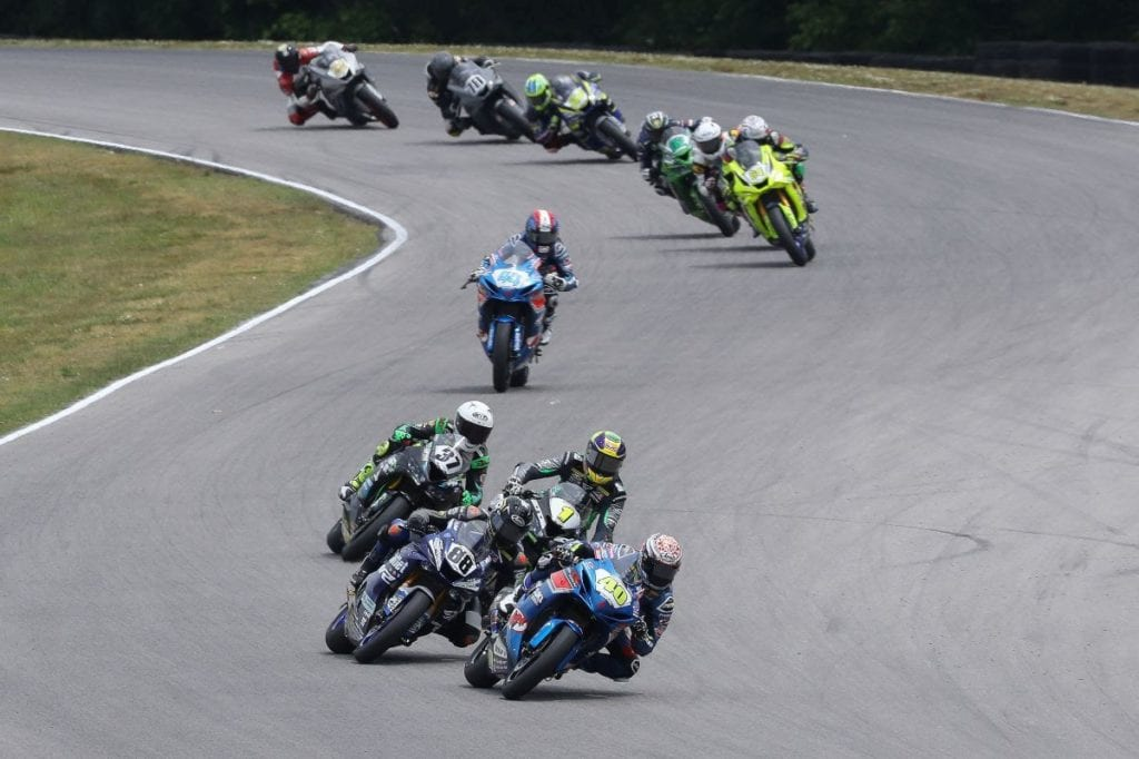 Sean Dylan Kelly (40) leads Benjamin Smith (88), Richie Escalante (1) and Stefano Mesa (97) during Supersport action on Saturday.  Photo by Brian J. Nelson